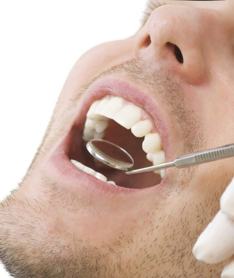 Dental Mirror Inspecting Male's Mouth