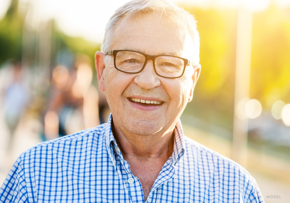 Mature Male In Glasses Smiling Outside